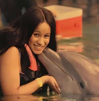 Cardi B receives a dolphin kiss