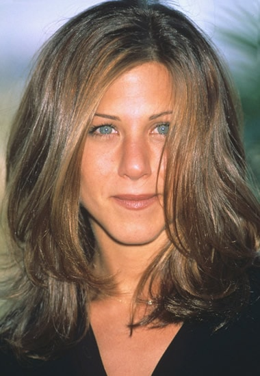 Young Jennifer Aniston with long curls