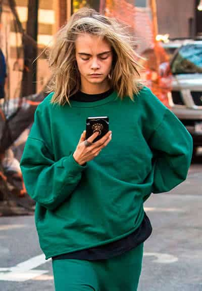 Cara Delevingne should focus on the road instead of her phone