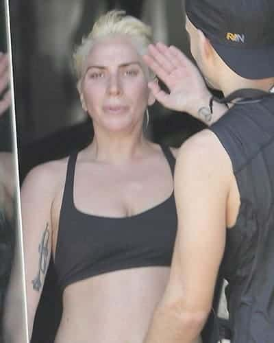 Lady Gaga waving at the gym without makeup