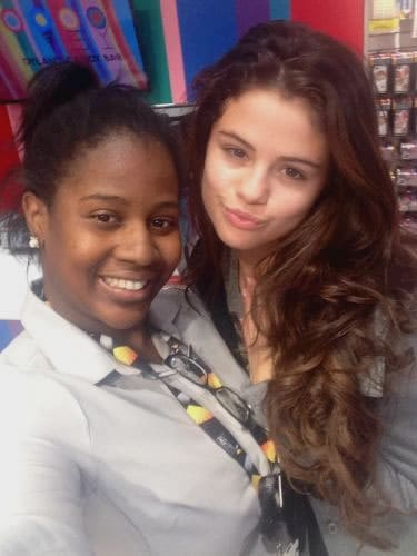 Selena Gomez posing for a fan photo without makeup