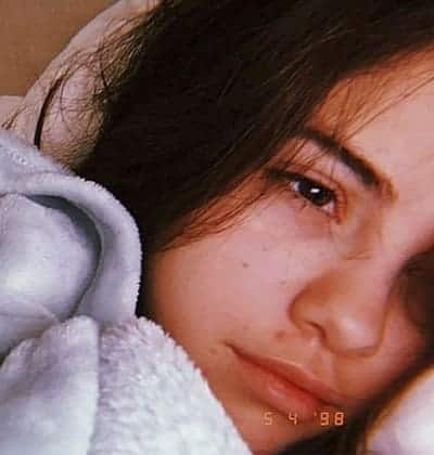 Selena Gomez showing the sadness in her eyes in this makeup free photo on Instagram