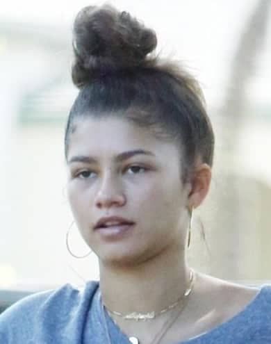Zendaya with a messy hair bun