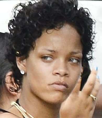 Rihanna with short curly hair and no makeup