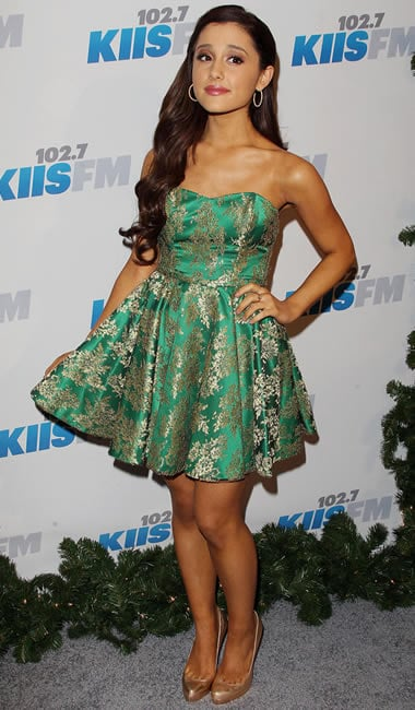 Ariana Grande with an exotic tan and a matching green piece