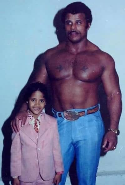 Young Dwayne Johnson with his muscular father who has strong genes