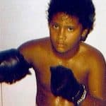 Dwayne Johnson posing as a young boxer