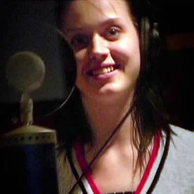 Katy Perry recording in a studio and makeup free