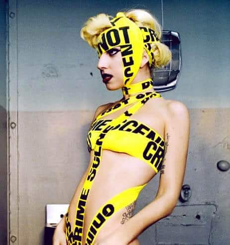 Lady Gaga crazy outfit using police crime scene tape