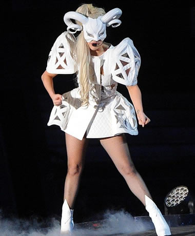 Lady Gaga puts on a white demon mask and costume with horns