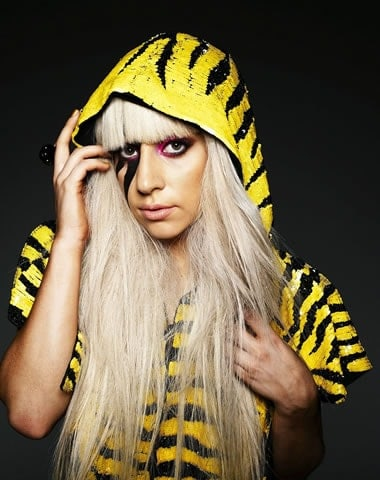 Lady Gaga in a yellow tiger pattern raincoat