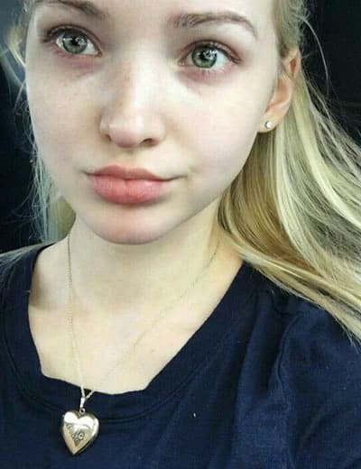 Dove Cameron wearing the heart of gold