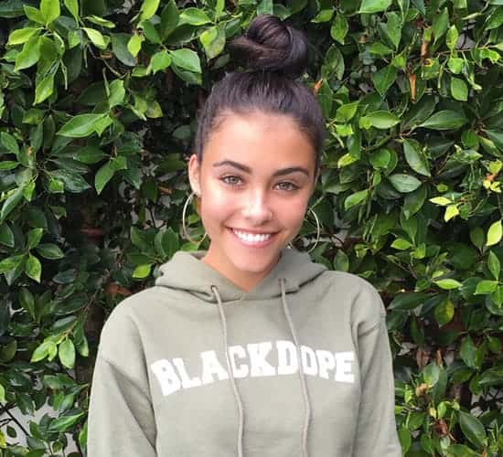 Madison Beer with leafy background