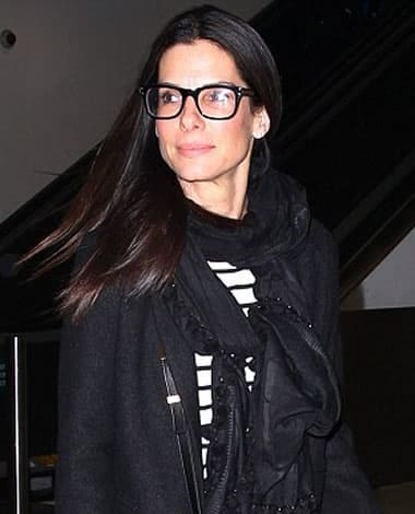 Sandra Bullock wearing eye-catching glasses