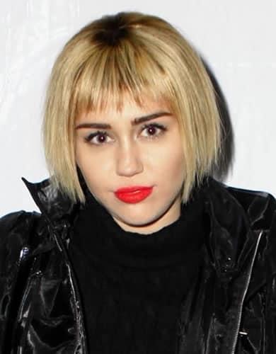 Miley Cyrus with a cute bob haircut and bangs
