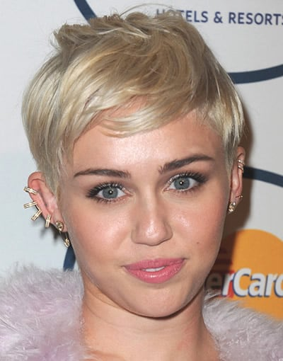 Miley Cyrus sporting a low maintenance chic pixie haircut in 2014