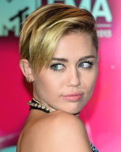 Miley Cyrus signature side-swept fringe hairstyles