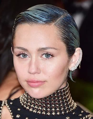 Miley Cyrus with short blue slicked back wet look hair in 2015