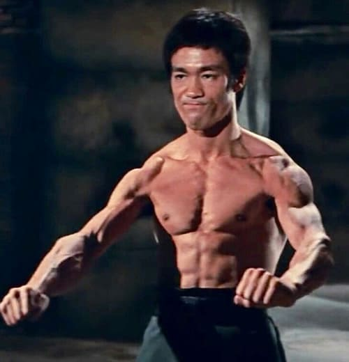 Bruce Lee flexing his muscular body