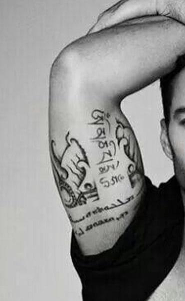Ricky Martin right inner arm tattoo