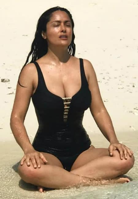 Salma Hayek is meditating at the beach
