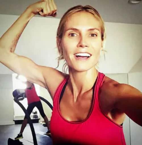 Heidi Klum flexing her muscles
