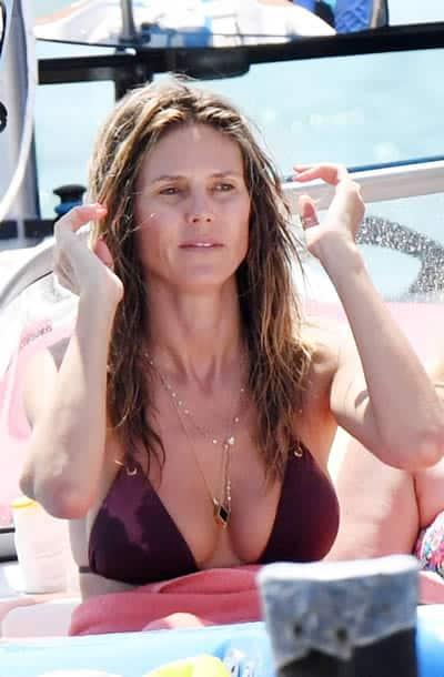 Heidi Klum on a rafting trip by the beach