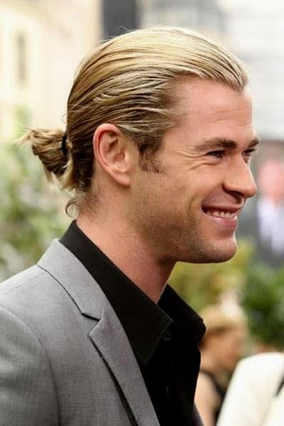 Chris Hemsworth tied a mini ponytail bun