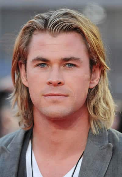 Chris Hemsworth looks like a surfer with those medium-long hair