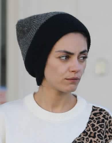 Mila Kunis keeping herself warm in a beanie