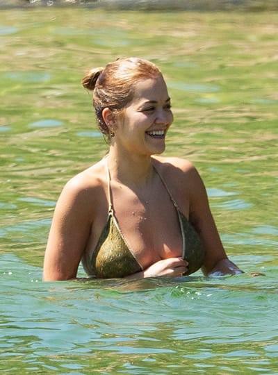 Rita Ora taking a dip at the beach