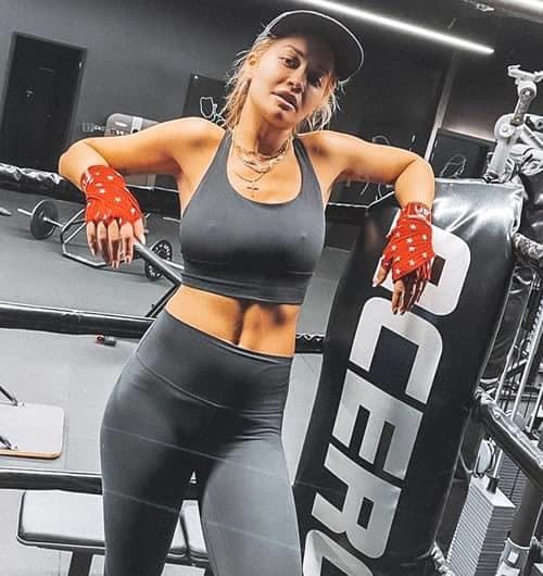 Rita Ora in a boxing gym